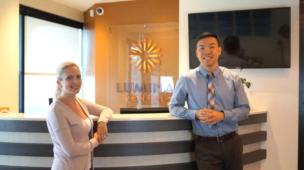 Dr Jiang and associate at Lumina Dental reception.